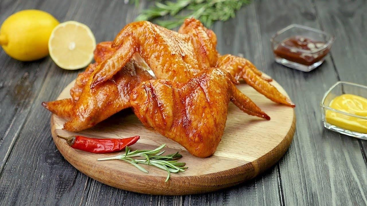 Куриные крылышки в томатном маринаде, запеченные в духовке