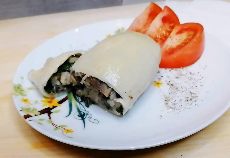 Фаршированные кальмары в духовке с рисом и грибами