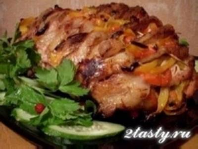 Свинина запеченная с овощами в духовке