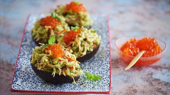 Фаршированные авокадо с крабовым салатом - необычная закуска к праздничному столу